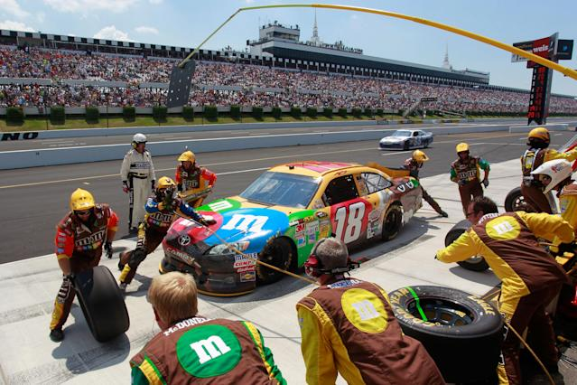 LONG POND, PA - JUNE 10: Kyle Busch pits the #18 M&M's Toyota during the NASCAR Sprint Cup Series Pocono 400 presented by #NASCAR at Pocono Raceway on June 10, 2012 in Long Pond, Pennsylvania. (Photo by Geoff Burke/Getty Images for NASCAR)