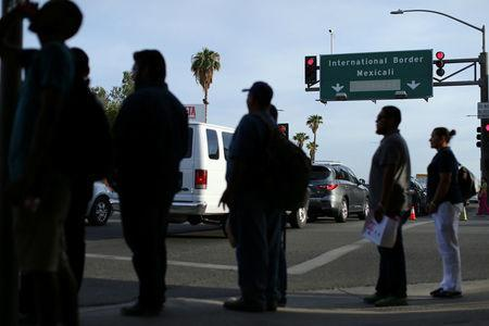 Pedestrians wait to cross the street in Calexico, California, Unites States, October 7, 2016. REUTERS/Mike Blake