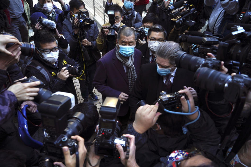 Hong Kong pro-democracy activist and media tycoon Jimmy Lai, center, arrives the Court of Final Appeal in Hong Kong, Thursday, Dec. 31, 2020. Hong Kong government prosecutors appeal against the bail granted to Lai. Lai was granted bail on Dec 23, nearly three weeks after he was remanded in custody over fraud and national security-related charges. (AP Photo/Kin Cheung)