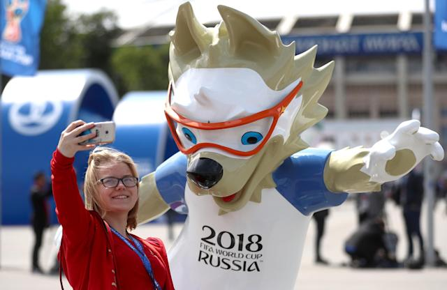 <p>Fans pose with a Mascot ahead of the opening match of the 2018 FIFA World Cup </p>