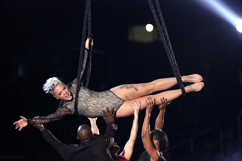FILE - In this Jan. 26, 2014 file photo, Pink performs at the 56th annual Grammy Awards at Staples Center, in Los Angeles. Producers of the 86th Academy Awards announced Friday, Feb. 21, 2014, that Pink will appear on the Oscar show on March 2, 2014, in Los Angeles. The Grammy-winning singer joins a lineup already set to include performances from U2, Pharrell Williams, Bette Midler, rocker Karen O and Broadway star Idina Menzel. (Photo by Matt Sayles/Invision/AP, file)