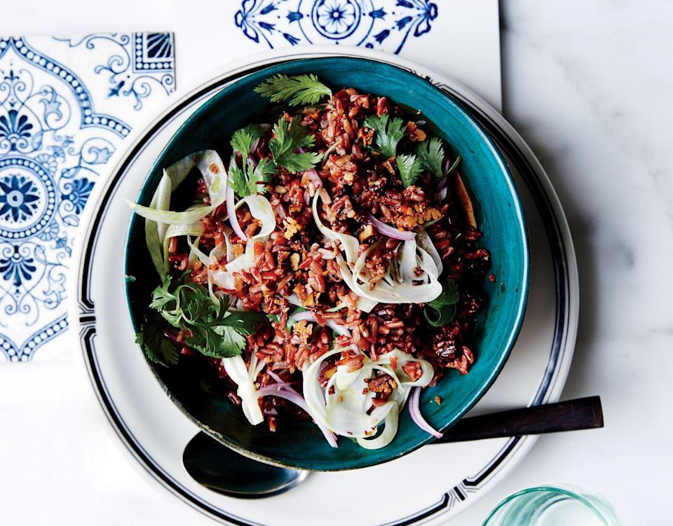 """Red rice is a short-grain, nutty-tasting type; you can use short-grain brown rice in its place. <a href=""""https://www.bonappetit.com/recipe/red-rice-salad-with-pecans-fennel-and-herbs?mbid=synd_yahoo_rss"""" rel=""""nofollow noopener"""" target=""""_blank"""" data-ylk=""""slk:See recipe."""" class=""""link rapid-noclick-resp"""">See recipe.</a>"""