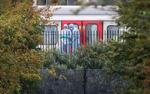 Forensic investigators search next to a London underground tube at Parsons Green - Credit: HANNAH MCKAY/REUTERS