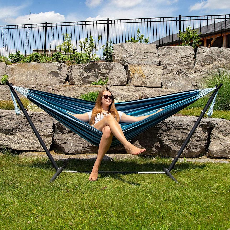 <p>The <span>Vivere Double Cotton Hammock </span> ($120) is such a summertime vibe, just imagine reading your favorite book and louging in the sun in this cozy hammock. It has a 450-pound capacity and a foldable steel stand. It comes in a variety of colors and patterns so you can choose the best one for your outdoor aesthetic. </p>