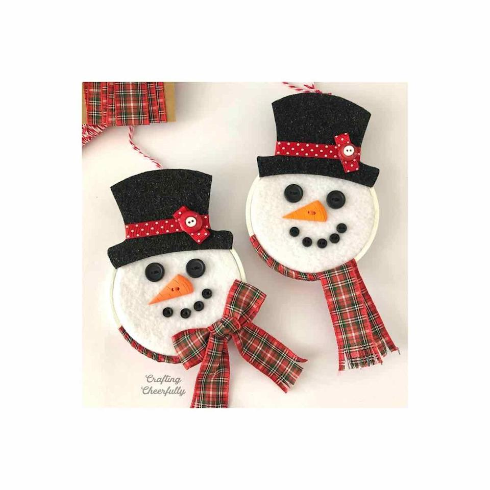"""<p>An embroidery hoop helps add dimension to this adorable Christmas craft. </p><p><em>Get the tutorial at <a href=""""https://www.craftingcheerfully.com/diy-snowman-hoop-ornament/"""" rel=""""nofollow noopener"""" target=""""_blank"""" data-ylk=""""slk:Crafting Cheerfully"""" class=""""link rapid-noclick-resp"""">Crafting Cheerfully</a>. </em></p><p><a class=""""link rapid-noclick-resp"""" href=""""https://www.amazon.com/Similane-Pieces-Embroidery-Bamboo-Circle/dp/B07WNZL6CL?tag=syn-yahoo-20&ascsubtag=%5Bartid%7C10072.g.34443405%5Bsrc%7Cyahoo-us"""" rel=""""nofollow noopener"""" target=""""_blank"""" data-ylk=""""slk:SHOP EMBROIDERY HOOP"""">SHOP EMBROIDERY HOOP</a></p>"""
