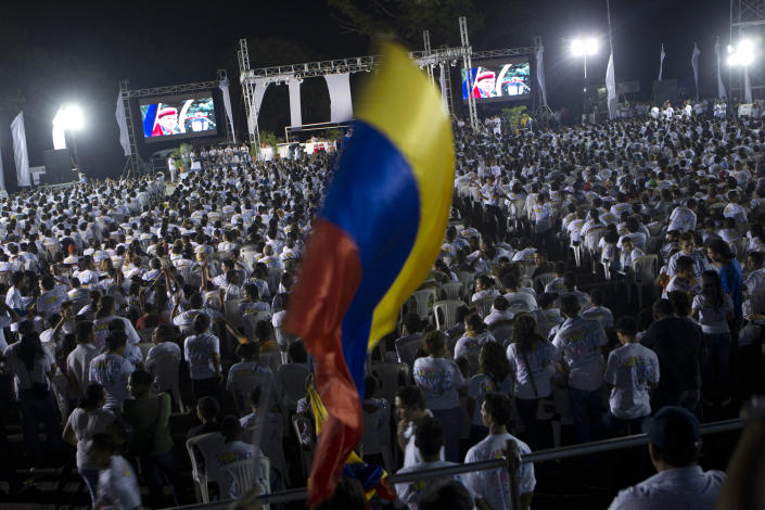 """Supporters of Venezuela's President Hugo Chavez gather during a vigil in Managua, Nicaragua, Sunday Dec. 9, 2012. Chavez is to return to Cuba Sunday for another surgery in his battle against cancer, which has led him to speak publicly of a successor for the first time. Chavez said Saturday that if there are """"circumstances that prevent me from exercising the presidency further"""" Vice-President Nicolas Maduro should replace him for the remainder of his term.(AP Photo/Esteban Felix)"""