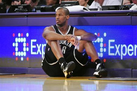 Brooklyn Nets center Jason Collins (46) waits to enter the game against the Los Angeles Lakers during the second half at Staples Center. Mandatory Credit: Gary A. Vasquez-USA TODAY Sports