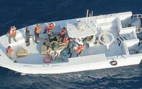 Imagery taken from a US Navy helicopter of what the US say is the Islamic Revolutionary Guard Corps Navy after removing an unexploded limpet mine from a tanker - REX