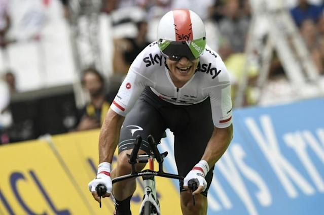 Poland's Michal Kwiatkowski crosses the finish line at the Velodrome stadium at the end of an individual time-trial, the twentieth stage of the 104th edition of the Tour de France cycling race on July 22, 2017