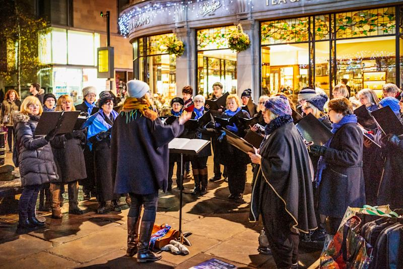 York, UK - A choir performing on the streets of York as Christmas approaches.