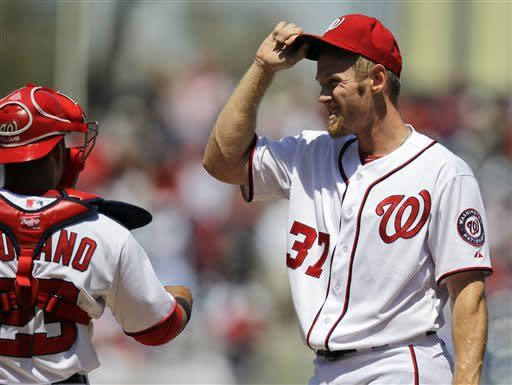 Washington Nationals catcher Jhonatan Solano (23) talks with starting pitcher Stephen Strasburg (37) during the first inning of a baseball game against the St. Louis Cardinals at Nationals Park, Wednesday, April 24, 2013, in Washington. (AP Photo/Alex Brandon)