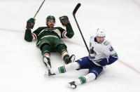 Minnesota Wild's Marcus Foligno (17) and Vancouver Canucks' Elias Pettersson (40) react after colliding during second-period NHL hockey game action in Edmonton, Alberta, Thursday, Aug. 6, 2020. (Jason Franson/The Canadian Press via AP)