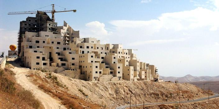 New houses under construction in 2003 in the Jewish settlement of Ma'ale Adumim, located in the West Bank.