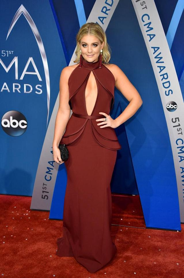 <p>Alaina kept her look monochromatic, with burgundy earrings to match her dress. (Photo: Getty Images) </p>