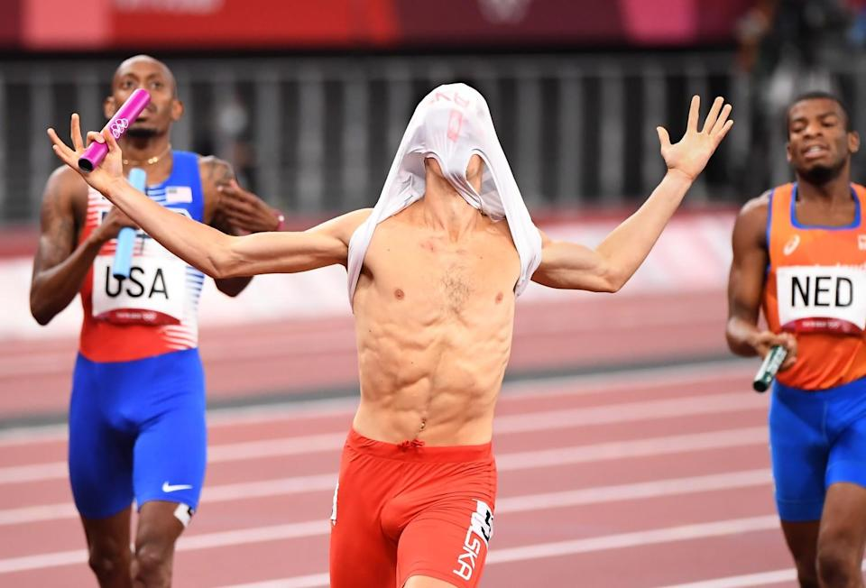 Kajetan Duszynski crosses the finish line first for team Poland and capture the 4X400 relay mixed race.