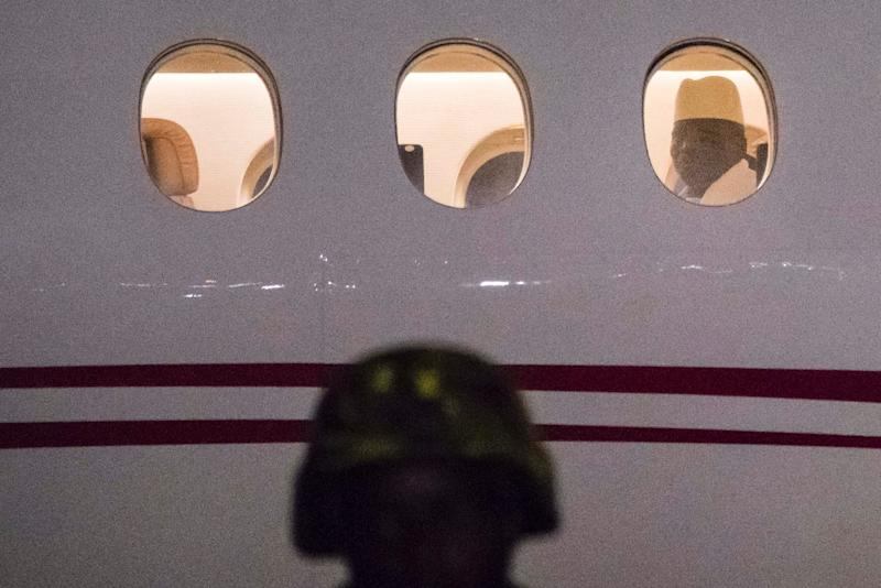 Former President Yaya Jammeh the Gambia's leader for 22 years, looks through the window from the plane as he leaves the country on 21 January 2017 in Banjul airport