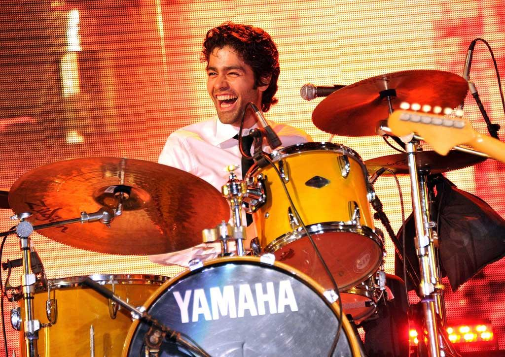 """Also having a ball in the Sunshine State was Adrian Grenier, who rocked out with his band The Honey Brothers at Orange Drive, South Beach's New Year's Festival. James Devaney/<a href=""""http://www.wireimage.com"""" target=""""new"""">WireImage.com</a> - January 2, 2011"""
