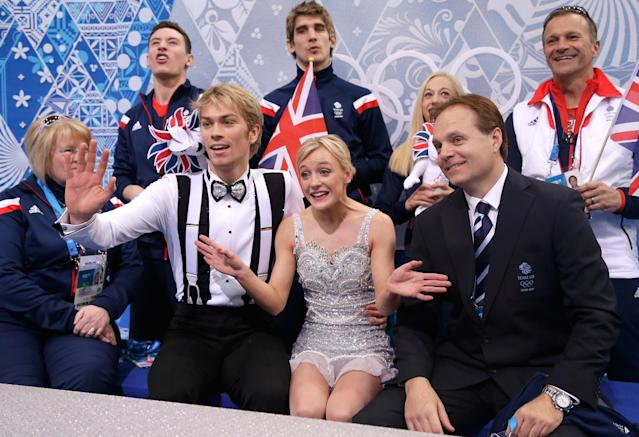 SOCHI, RUSSIA - FEBRUARY 08: Penny Coomes and Nicholas Buckland of Great Britain wait for their score with teammates and coaches during the Figure Skating Team Ice Dance - Short Dance during day one of the Sochi 2014 Winter Olympics at Iceberg Skating Palace on February 8, 2014 in Sochi, Russia. (Photo by Darren Cummings/Pool/Getty Images)
