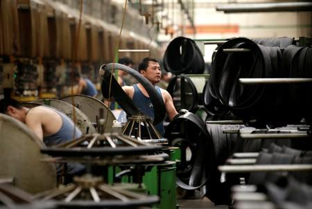 China's factory activity shrinks for fourth month as trade woes deepen