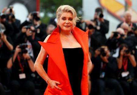 """French actor Deneuve poses at the red carpet for the movie """"The Truth"""" (La Verite) presented in competition at the 76th Venice Film Festival"""