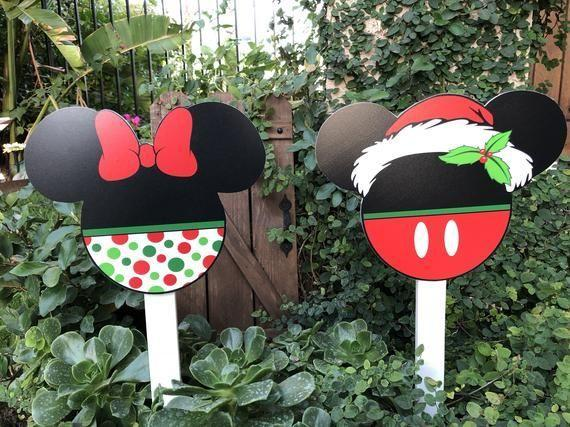 """<p><strong>LollipopsGalore</strong></p><p>etsy.com</p><p><strong>$40.00</strong></p><p><a href=""""https://go.redirectingat.com?id=74968X1596630&url=https%3A%2F%2Fwww.etsy.com%2Flisting%2F646314051%2Fchristmas-yard-decorations-disney&sref=https%3A%2F%2Fwww.womansday.com%2Fhome%2Fdecorating%2Fg34291455%2Foutdoor-christmas-decorations%2F"""" rel=""""nofollow noopener"""" target=""""_blank"""" data-ylk=""""slk:Shop Now"""" class=""""link rapid-noclick-resp"""">Shop Now</a></p><p><a href=""""https://www.womansday.com/life/travel-tips/a52952/christmas-at-disney-world/"""" rel=""""nofollow noopener"""" target=""""_blank"""" data-ylk=""""slk:Disney at Christmastime"""" class=""""link rapid-noclick-resp"""">Disney at Christmastime</a> is one of the most beautiful sights to see. Thankfully, the ongoing COVID-19 pandemic can't keep you from bringing a little Disney Christmas to your yard. </p>"""