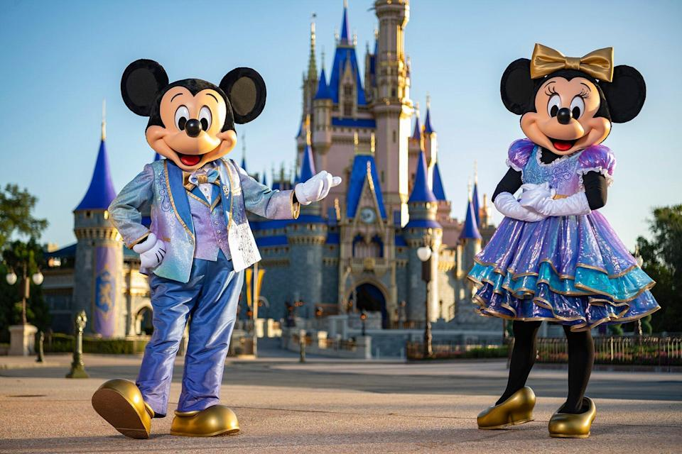 Mickey Mouse and Minnie Mouse in front of Cinderellas Castle at Walt Disney World Resort
