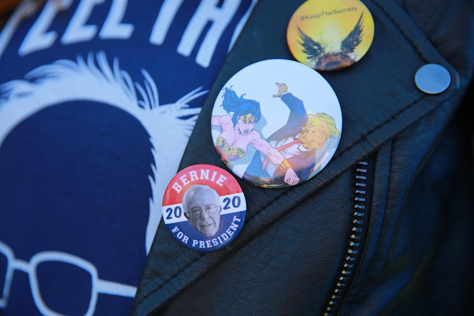 A supporters wears campaign buttons while waiting for Democratic presidential candidate Bernie Sanders as he campaigns at the Bernie's Back Rally in Long Island City, New York on Saturday, Oct. 19, 2019. (Photo: Gordon Donovan/Yahoo News)