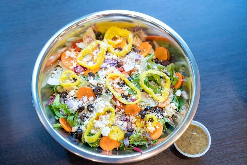 There are no pre-set salad options at Salata. But this Greek salad was put together with feta cheese, banana peppers, black olives, tomatoes, cucumbers, carrots, red onions and fresh herb vinaigrette on the side.