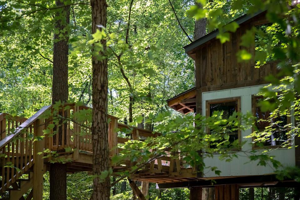 """<p>The cozy cottages at the <a href=""""https://www.themohicans.net/treehouses/"""" rel=""""nofollow noopener"""" target=""""_blank"""" data-ylk=""""slk:Mohicans Treehouse Resort"""" class=""""link rapid-noclick-resp"""">Mohicans Treehouse Resort</a>, a 77-acre destination in Ohio's Amish Country, have panoramic views of the surrounding woods. Choose from nine different tree-lined villas, including the Little Red Treehouse—which was designed by treehouse designer Pete Nelson, who featured the spot on the Discovery series """"Treehouse Masters."""" </p>"""