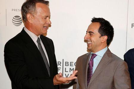 Actors Amir Talai (R) and Tom Hanks arrive for 'The Circle' premiere at the Tribeca Film Festival in the Manhattan borough of New York, New York, U.S. April 26, 2017.   REUTERS/Carlo Allegri