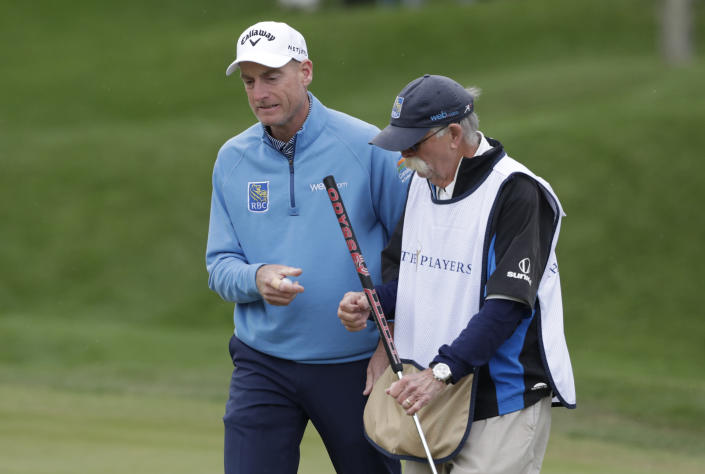 FILE - Jim Furyk, left, and his caddie Mike Cowan talk on the second hole during the final round of The Players Championship golf tournament in Ponte Vedra Beach, Fla., in this Sunday, March 17, 2019, file photo. Furyk and Cowan have been together for 22 years. (AP Photo/Lynne Sladky, File)