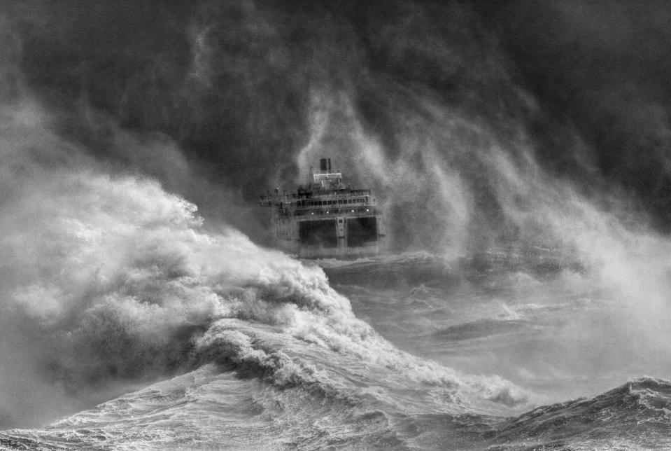 <p>The overall winner of the UK's best sea view competition was taken by David Lyon in Newhaven, East Sussex, with a dramatic scene of huge waves crashing into the path of a ferry. (Image: David Lyon)</p>