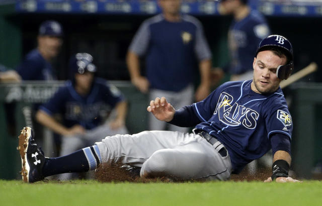 Tampa Bay Rays' Johnny Field slides home to score on a single by Joey Wendle during the ninth inning of a baseball game against the Kansas City Royals on Tuesday, May 15, 2018, in Kansas City, Mo. (AP Photo/Charlie Riedel)