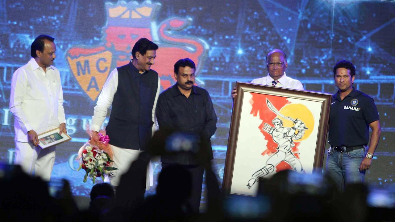 Indian cricketer Sachin Tendulkar, Union Agriculture Minister and MCA (Mumbai Cricket Association) president Sharad Pawar, Maharashtra Chief Minister Prithviraj Chavan and Mumbai Mayor Sunil Prabhu during the rechristening ceremony of MCA sport complex at Kandivali West Mahavir Nagar as `Sachin Tendulkar Gymkhana` in Mumbai on Nov.11, 2013.(Photo: Sandeep Mahankaal/IANS)