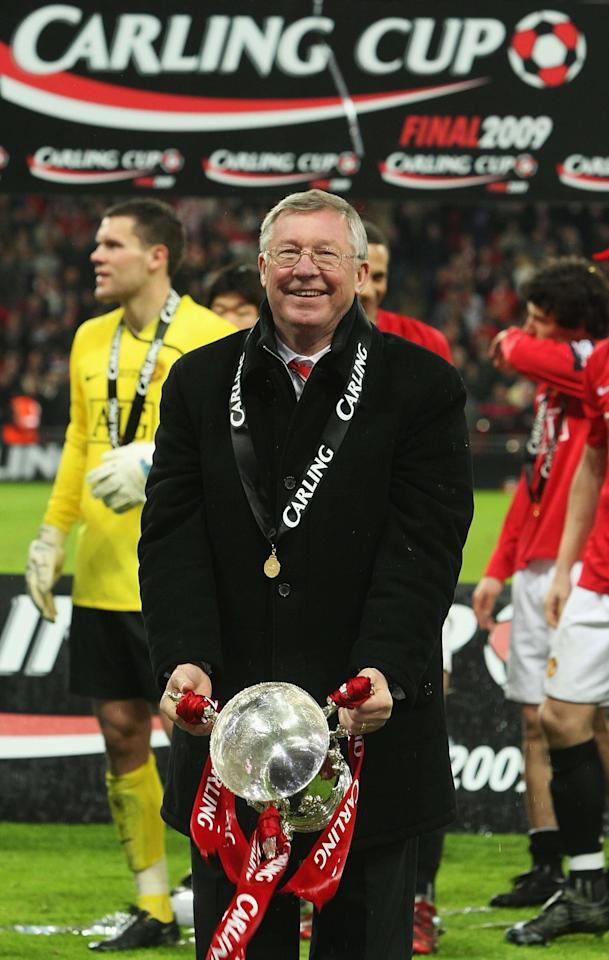 LONDON, ENGLAND - MARCH 1:  Sir Alex Ferguson of Manchester United poses with the Carling Cup trophy after the Carling Cup Final match between Manchester United and Tottenham Hotspur at Wembley Stadium on March 1 2009 in London, England. (Photo by John Peters/Manchester United via Getty Images)