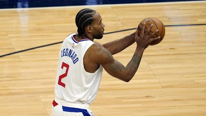 Los Angeles Clippers' Kawhi Leonard (2) plays against the Minnesota Timberwolves in an NBA basketball game, Wednesday, Feb. 10, 2021, in Minneapolis. (AP Photo/Jim Mone)