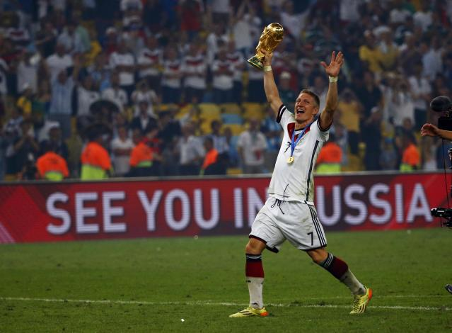 Germany's Bastian Schweinsteiger holds the World Cup trophy as he celebrates their 2014 World Cup final win against Argentina at the Maracana stadium in Rio de Janeiro July 13, 2014. REUTERS/Michael Dalder (BRAZIL - Tags: SOCCER SPORT WORLD CUP TPX IMAGES OF THE DAY)