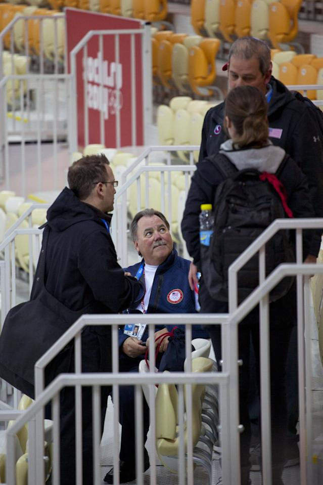 U.S. speedskating team members with president Mike Plant, center, huddle in the stands of the Adler Arena Skating Center after a disappointing start to the 2014 Winter Olympics, Thursday, Feb. 13, 2014, in Sochi, Russia. The U.S. team still has to win its first speedskating medal. (AP Photo/Peter Dejong)