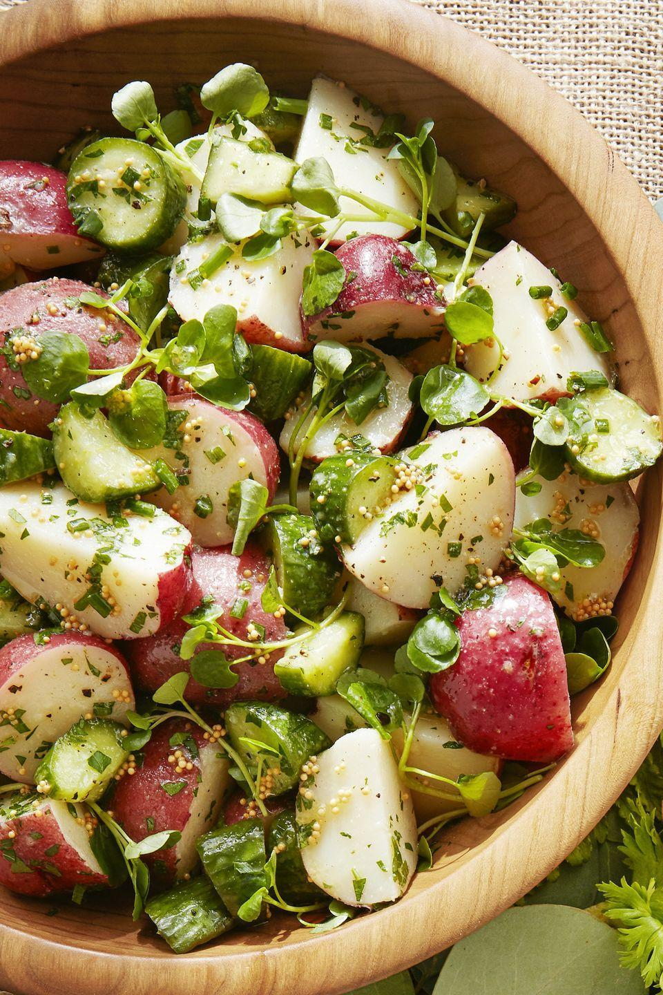 "<p>Skip the heavy egg-loaded potato salad and opt for this light, zesty version.</p><p><strong><a href=""https://www.countryliving.com/food-drinks/a19041163/tangy-potato-salad-recipe/"" rel=""nofollow noopener"" target=""_blank"" data-ylk=""slk:Get the recipe"" class=""link rapid-noclick-resp"">Get the recipe</a>.</strong><br></p>"