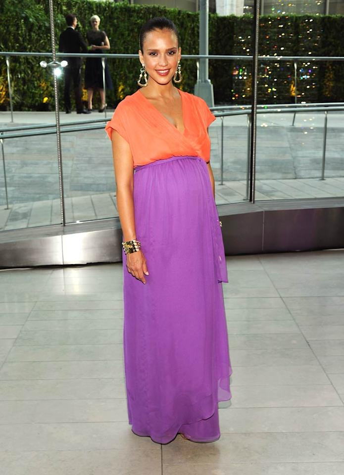 "An expectant Jessica Alba showed off her baby bump beneath plenty of bright colors on Monday at the 2011 CFDA Fashion Awards at New York's Lincoln Center. on Larry Busacca/<a href=""http://www.gettyimages.com/"" target=""new"">GettyImages.com</a> - June 6, 2011"