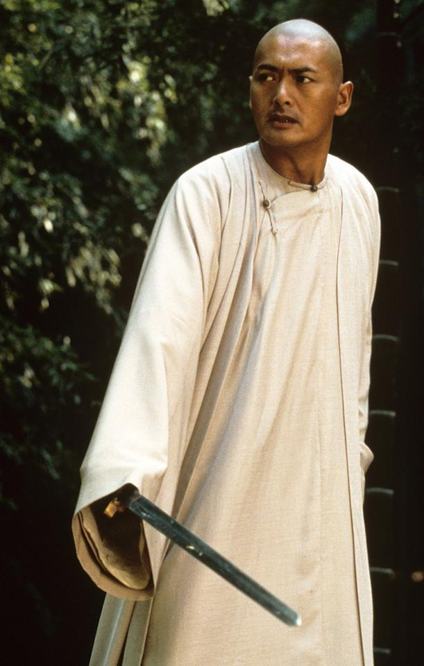 """<a href=""""http://movies.yahoo.com/movie/contributor/1800019656"""">CHOW YUN FAT</a>, <a href=""""http://movies.yahoo.com/movie/1800424121/info"""">Crouching Tiger Hidden Dragon</a>  Chow Yun Fat dropped his trench coat, shades and virile head of hair for a shaved head, a tunic, and some serious kung fu moves."""