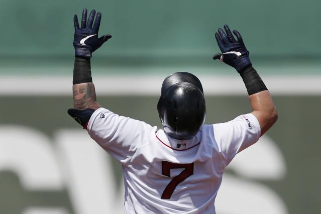 Boston Red Sox's Christian Vazquez celebrates his double during the 10th inning of a baseball game against the Kansas City Royals that was suspended by rain with the scored tied on Aug. 8, and continued at Fenway Park in Boston, Thursday, Aug. 22, 2019. The Red Sox beat the Royals 5-4. (AP Photo/Michael Dwyer)