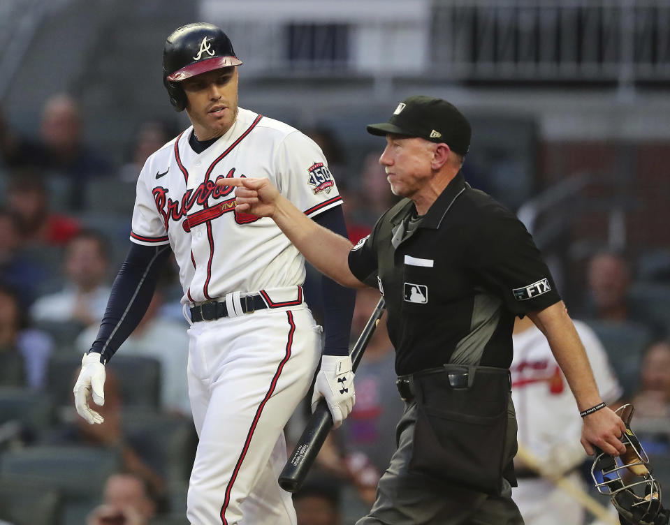 Home plate umpire Lance Barksdale awards Atlanta Braves first baseman Freddie Freeman first base after he was hit by a pitch by Washington Nationals starting pitcher Sean Nolin, who was ejected during the first inning of a baseball game Wednesday, Sept 8, 2021, in Atlanta. (Curtis Compton/Atlanta Journal-Constitution via AP)