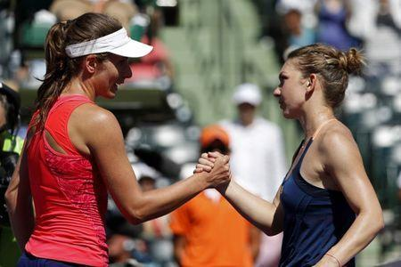 Mar 29, 2017; Miami, FL, USA; Johanna Konta of Great Britain (left) shakes hands with Simona Halep of Romania (right) after their match on day nine of the 2017 Miami Open at Crandon Park Tennis Center. Konta won 3-6, 7-6(7), 6-2. Geoff Burke-USA TODAY Sports