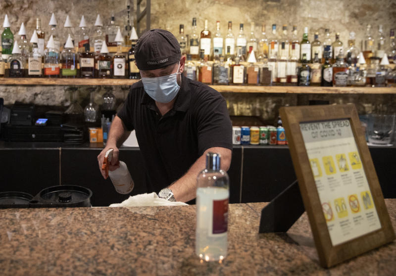 Jun 26, 2020; Austin, TX, USA; Kevin Shipp, operating partner of Cedar Street Courtyard, closes his bar on West 4th Street in Austin, Texas, on Friday June 26, 2020, after Gov. Greg Abbott ordered all bars in Texas to be closed due to the coronavirus. Mandatory Credit: Jay Janner/American-Statesman via USA TODAY NETWORK/Sipa USA