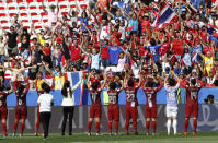 Thailands players celebrate in front of their supporters after the Women's World Cup Group F soccer match between Sweden and Thailand at the Stade de Nice in Nice, France, Sunday, June 16, 2019. Sweden defeated Thailand by 5-1. (AP Photo/Claude Paris)