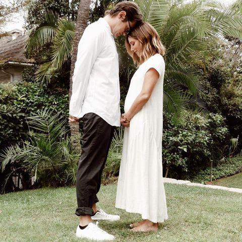 """<p>The High School Musical star recently announced that she's expecting her first child with her husband, Christopher French.</p><p>Taking to Instagram to share their news with her fans, Tisdale and French wear matching coordinated white outsides in their announcement photo, with the actress holding her growing baby bump in her arms.</p><p>The star's HSM actress' co-star Vanessa Hudgens commented on the post: 'Just the freaking cutest.'</p><p><a href=""""https://www.instagram.com/p/CFPeyj4lLDt/?utm_source=ig_web_copy_link"""" rel=""""nofollow noopener"""" target=""""_blank"""" data-ylk=""""slk:See the original post on Instagram"""" class=""""link rapid-noclick-resp"""">See the original post on Instagram</a></p>"""