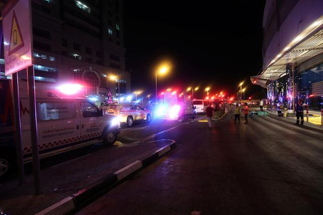 <p>Dubai Emergency Response teams and Dubai police are seen on the street near Dubai's Torch tower residential building in the Marina district, Dubai, U.A.E., early hours of August 4, 2017. (Photo: Hamad I Mohammed/Reuters) </p>