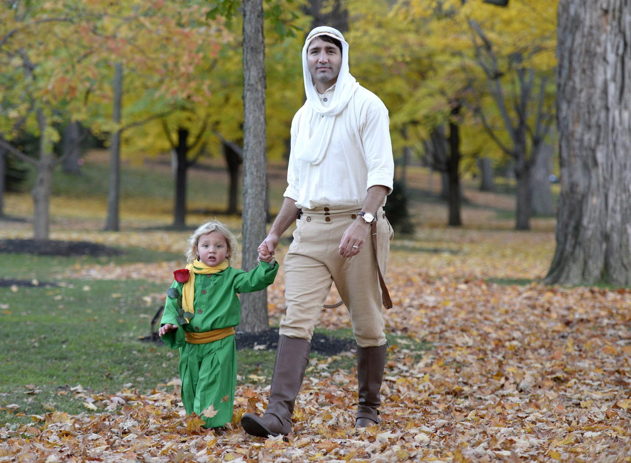 <p>Acting as his son's greatest sidekick in 2016, the Prime Minister dressed up as the pilot to his son's Petit Prince. An ode to the children's book, the pair were spotted trick-or-treating in Ottawa with their complementary costumes. <em>(Photo via The Canadian Press)</em> </p>