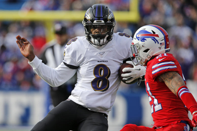 Baltimore Ravens quarterback Lamar Jackson (8) runs with the ball during the first half of an NFL football game against the Buffalo Bills in Orchard Park, N.Y., Sunday, Dec. 8, 2019. (AP Photo/John Munson)